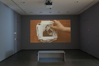 Installation view, Andrea Geyer. <em>Insistence</em>. 2013. Video (color, sound). 15:21 min. The Museum of Modern Art, New York. The Modern Women's Fund. ©2015 Andrea Geyer, courtesy Galerie Thomas Zander, Cologne. The Museum of Modern Art (October 16–November 15, 2015). Digital image © 2015 The Museum of Modern Art, New York. Photo: John Wronn.