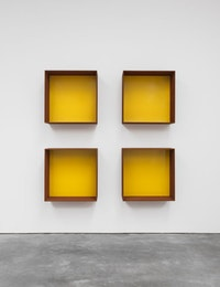 Donald Judd, <em>Untitled</em>, 1991. Cor-ten steel and yellow paint. Four units, each: 39 3/8 x 39 3/8 x 19 11/16 inches. Art © Judd Foundation. Licensed by VAGA, New York, NY; courtesy David Zwirner, New York/London.