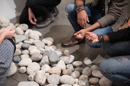 Installation view: Yoko Ono, <em>Stone Piece</em>, 2015/2016. Local riverbed rocks. Dimensions variable. Courtesy Andrea Rosen Gallery, New York. (C) Yoko Ono. Photo: Pierre Le Hors