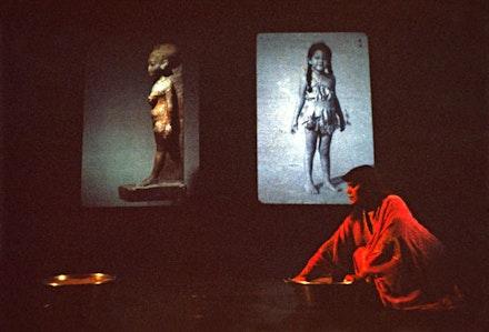 Performance View: Lorraine O'Grady, <em>Nefertiti/Devonia Evangeline</em> (1980 – 88): Told to swing an incense censer, she stirs sand instead. Photo: Freida Leinwand. Courtesy Alexander Gray Associates, New York.