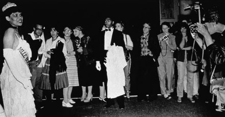Performance View: Lorraine O&#146;Grady, <em>Mlle Bourgeoise Noire Goes to the New Museum</em> (1981): Crowd watches Mlle Bourgeoise Noire as she shouts her poem. Photo: Coreen Simpson and Salimah Ali. Courtesy Alexander Gray Associates, New York.