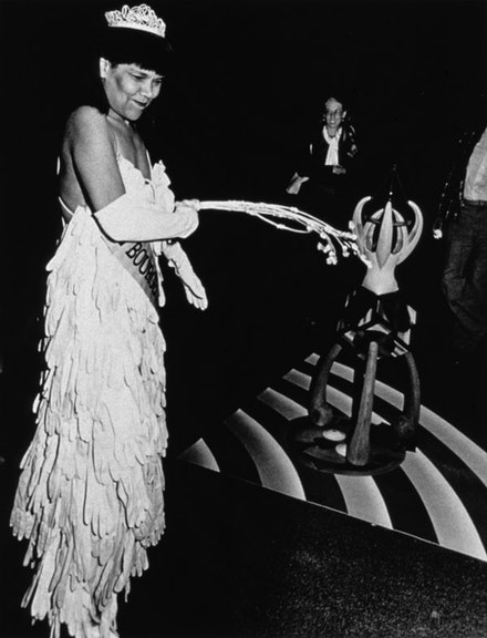 Lorraine O'Grady, <em>Mlle Bourgeoise Noire Goes to the New Museum</em> (1981): Mlle. Bourgeoise Noire beats herself with the whip-that-made-plantations-move. Photo: Coreen Simpson and Salimah Ali. Courtesy Alexander Gray Associates, New York.
