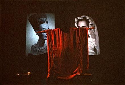 "Lorraine O'Grady, <em>Nefertiti/Devonia Evangeline</em> (1980 – 88):  e voice on tape says: ""Mount and straddle tubs of sand, which are now touching. . . face audience."" Photo: Freida Leinwand. Courtesy Alexander Gray Associates, New York."