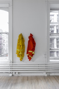 "Cameron Rowland, <i>1st Defense NFPA 1977, 2011</i>, 2016. Nomex fire suit, distributed by CALPIA, 50 x 13 x 8 inches. Rental at cost.""The Department of Corrections shall require of every able-bodied prisoner imprisoned in any state prison as many hours of faithful labor in each day and every day during his or her term of imprisonment as shall be prescribed by the rules and regulations of the Director of Corrections."" - California Penal Code 2700CC35933 is the customer number assigned to the nonprofit organization California College of the Arts upon registering with the CALPIA, the market name for the California Department of Corrections and Rehabilitation, Prison Industry Authority. Inmates working for CALPIA produce orange Nomex fire suits for the state's 4300 inmate wildland firefighters.Courtesy of the artist and ESSEX STREET, New York. Photo: Adam Reich."
