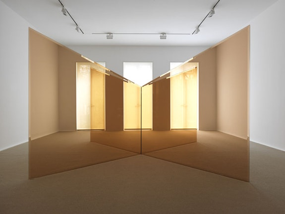 Larry Bell<em>, Untitled Trapezoid Improvisation</em>, 1983. Amber laminated glass. Unique. 4 panels. 60 x 72 x .5 inches / 72 x 102 1/8 x 102 1/8 inches (overall). Courtesy the artist and Hauser &amp; Wirth. Photo: Genevieve Hanson.