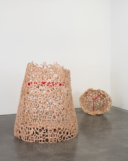Pope.L, <em>Cone in a Forest and Cone for My Sister (Private Language Problem)</em>, 2015. Plywood letter cutouts, hot glue and corrugated plastic, 47&#8201;&times;&#8201;47&#8201;&times;&#8201;45 inches. &copy; Pope.L. Courtesy the artist and Andrea Rosen Gallery. Photo: Pierre Le Hors.