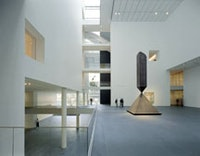 "<i>The Museum of Modern Art, designed by Yoshio Taniguchi. The Donald B. and Catherine C. Marron Atrium looking east towards 5th Avenue with Barnett Newman's ""Broken Obelisk"" (1963-69) and Willem de Kooning's ""Pirate (Untitled II)"" (1981). © 2005 Timothy Hursley.</i>"