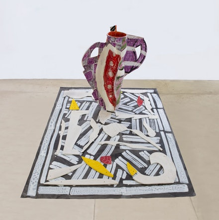 Betty Woodman, <em>Aztec Vase and Carpet #1</em>, 2012. Glazed earthenware, epoxy resin, lacquer, paint, and canvas, 59 1/2  × 49 × 34 inches. Courtesy the artist. Photo: Bruno Bruchi.