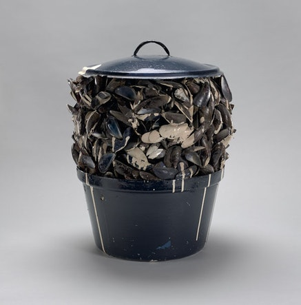 Marcel Broodthaers, <em>Moules sauce blanche (Mussels with white sauce)</em>, 1967. Painted pot, mussel shells, paint, and tinted resin, 14 3/4 inches diam.; 19 1/8 inches high. Private collection, New York. &copy; 2016 Estate of Marcel Broodthaers / Artists Rights Society (ARS), New York / SABAM, Brussels. Courtesy the Museum of Modern Art, New York.