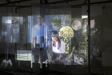 Ne&iuml;l Beloufa. <em>People&rsquo;s passion</em>, lifestyle, beautiful wine, gigantic glass towers, all surrounded by water. 2011. Video, 10 min, 59 sec. Installation view: Schinkel Pavilion, <em>Hopes for the Best</em>, April 4 &#150; May 31, 2015. Courtesy the artist, Fran&ccedil;ois Ghebaly Gallery, Mendes Wood DM, and ZERO, Milan. Photo: Andreas Rossetti.