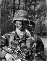 Film still from <i>Army of One</i>. This documentary features Sara Miller, a soldier who enlists in the U.S. army soon after 9/11. Directed by Sarah Goodman, 2003. Distributed by Redstorm.