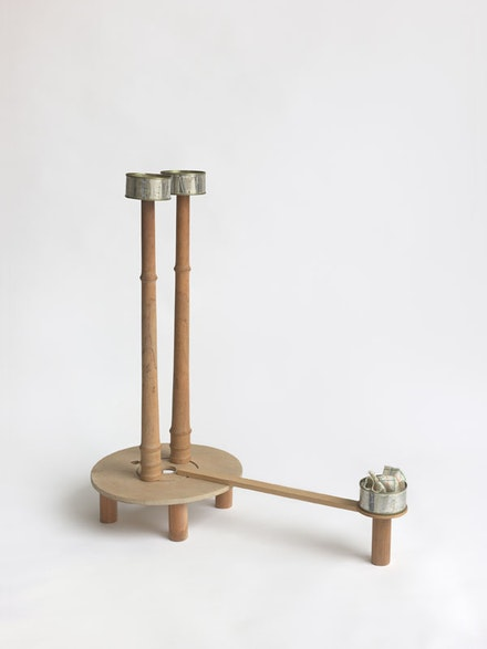 B. Wurtz, <em>Untitled (cans with pier)</em>, 1989. Wood, tin, cans, cloth. 26 1/4 x 25 1/4 x 12 inches. Courtesy Metro Pictures, New York.