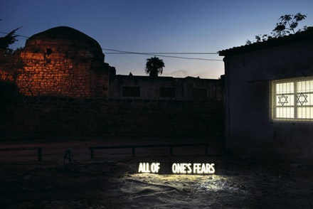 Shimon Attie, <em>ALL OF ONE'S FEARS, Two on-location light boxes, sited between Synagogue and ruins of former Mosque attacked by rioting Israelis during second Intifada, Cvar Shalem neighborhood, Tel Aviv</em>, 2014. Digital c-print. 40 × 60 inches. ©Shimon Attie. Courtesy the artist and Jack Shainman Gallery.