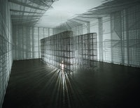 Mona Hatoum, <em>Light Sentence</em>, 1992. Galvanized wire mesh lockers, electric motor and light bulb. 198 x 185 x 490 cm. Centre Pompidou, Musée National d'Art Moderne, Paris: Mnam-CCI / Dist RMN-GP. Photo: Philippe Migeat. © Mona Hatoum.