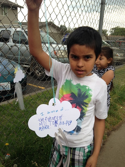 A boy from Orchard Homes housing complex in Milton-Freewater, with the cloud