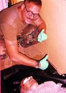Specialist Charles Graner with the body of Manadel Al-Jamadi, and Iraqi detainee killed during interrogation on November 4, 2003, and packed in ice to escape detection.
