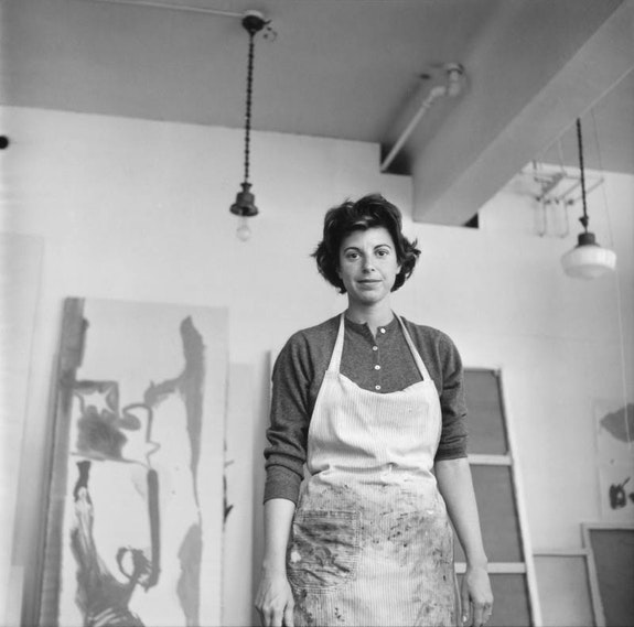 Helen Frankenthaler in her studio in front of <em>Swan Lake Series</em> (in progress) at East 83rd St. and Third Ave., New York, 1961. Helen Frankenthaler papers, Helen Frankenthaler Foundation Archives, New York. Photographer: Cora Kelley Ward.