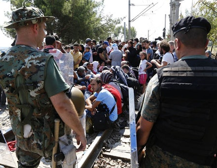 Syrian refugees wait to cross the Greek-Macedonia border at Gevgelija, 24 August 2015. Used under (CC BY-SA 2.0).