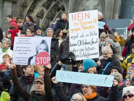 "Protesters gather outside Cologne Cathedral with a sign reading ""No to violence against women"", 2016. Photo: Elke Wetzig. Used under (CC BY-SA 4.0)."