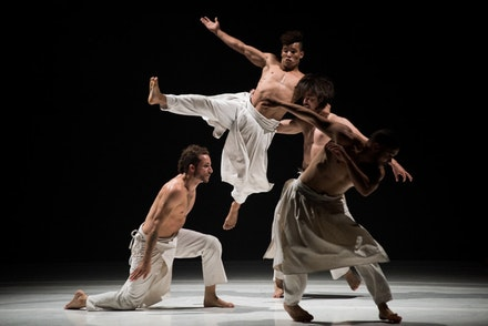 Dancers: Diovanni MARTINAT, Mourad MESSAOUD, Amine MAAMAR KOUADRI, and Nassim HENDI of Compagnie Herv&eacute; KOUBI in <i>What the Day Owes to the Night</i> (<i>Ce que le jour doit &agrave; la nuit</i>). Photo: Cherylynn Tsushima.
