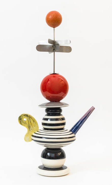 Peter Shire, <em>Spun Orbit</em>, 2006. Cone 06 clay and underglazes, with stainless steel detail. 26 x 12 x 7 inches. Courtesy of Derek Eller Gallery.