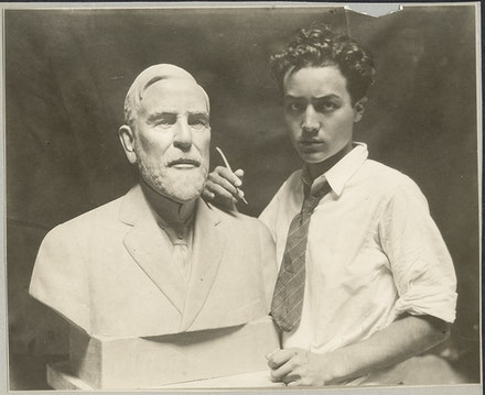 Isamu Noguchi in studio at work on bust of E.H. Scott, 1924. © The Isamu Noguchi Foundation and Garden Museum, New York / ARS.