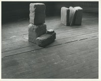 Beverly Buchanan  (American, 1940-2015).<em> Untitled (Slab Works 1)</em>, circa 1978 – 80.  Black-and-white photograph of cast concrete sculptures with acrylic  paint in artist  studio, 8 1/2  × 11 inches. Private collection. © Estate of Beverly Buchanan, courtesy  of Jane Bridges.