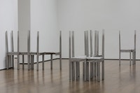 Installation view: <em>Thou-less</em> (detail) and untitled chair works in <em>Doris Salcedo: The Materiality of Mourning</em>, on display November 4, 2016 – April 9, 2017 at the Harvard Art Museums. © Doris Salcedo. Photo: Harvard Art Museums; © President and Fellows of Harvard College.