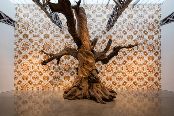 Installation view: <em>Ai Weiwei 2016: Roots and Branches</em>. <em>Tree</em> with <em>The Animal That Looks Like a Llama but is Really an Alpaca</em> wallpaper. Mary Boone Gallery, 541 West 24th Street, New York. Courtesy Mary Boone Gallery, New York.