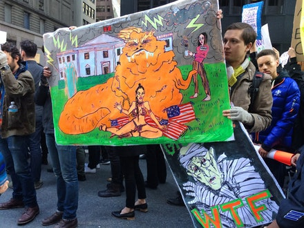 New York artists holding protest signs at recent demonstration against the election results, November 12, 2016.