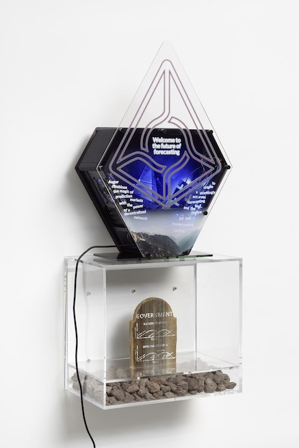 Simon Denny, <i>Blockchain Future State Fintech Gamer Case Mod Deal Toy: 21 Hype Cycle</i>, 2016. Lasercut Plexiglas and screenprint on Sand 3D print; Screenprint on wooden thombstone, lava stones, plexiglas. Casemod: 17.72 x 23.62 x 11.81 inches; Plexiplinth: 19.69 x 22.44 x 14.17 inches. Courtesy Petzel Gallery, New York.
