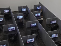 Kader Attia, <em>Reason's Oxymorons</em>, 2015. 18 films and installation of cubicles. Films 13 to 25 minutes. 55 × 262 × 468 inches (installed overall). Courtesy the Artist and Lehmann Maupin, New York and Hong Kong.