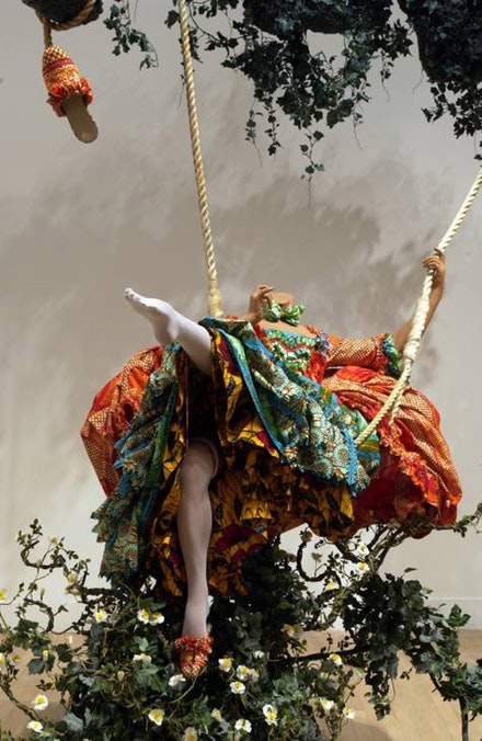 Yinke Shonibare, <em>The Swing (after Fragonard)</em>, 2001. Mannequin, cotton costume, 2 slippers, swing seat, 2 ropes, oak twig, and artificial foliage, approx. 3300 x 3500 x 2200 mm. Photo © Tate Modern.
