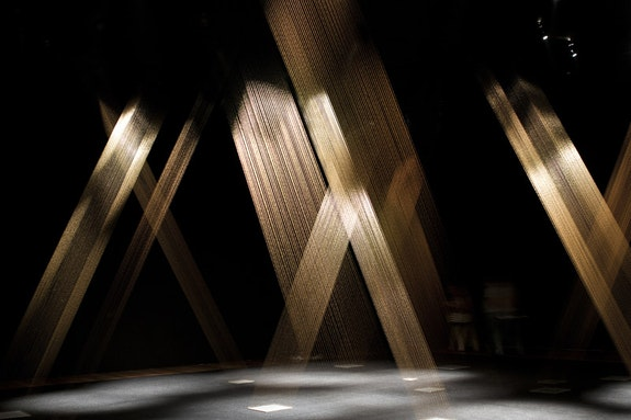 Lygia Pape,<em>Tt&#233;ia 1, C, </em>1976 &#8211; 2004; reconstructed 2017. Golden thread, nails, wood, and lighting.Prior installation view. Photo: Paula Pape. &#169; Projeto Lygia Pape.