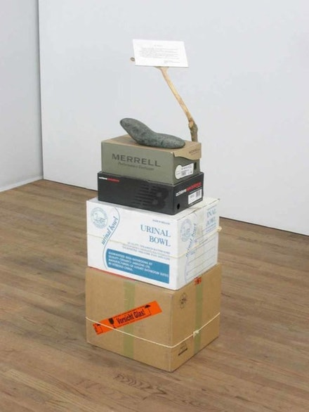 Jimmie Durham, <em>Anti-Brancusi</em>, 2005. Cardboard, wood, serpentine stone, rope, ink on paper. 48 × 17 × 31 ⅛ inches. Collection of Michel Rein, Paris.