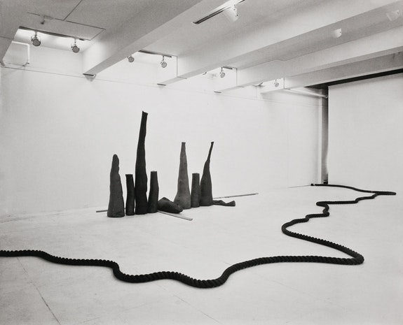 Installation view: <em>Barry Flanagan: New Work</em>. Fishbach Gallery, 1969. Left to right: <em>three space rope sculpture 2 '69</em> (1969), <em>nine shapes three timbers </em>(1968).