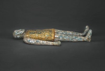 <p><em>Burial Ensemble of Dou Won</em>, Western Han Dynasty (206 BCE – 9 CE). Suit: jade with gold wire; pillow: gilt bronze and jade; orifice plugs: jade. 67 11/16 x 30 7/8 x 11 1/2 inches. Courtesy Metropolitan Museum of Art.</p>