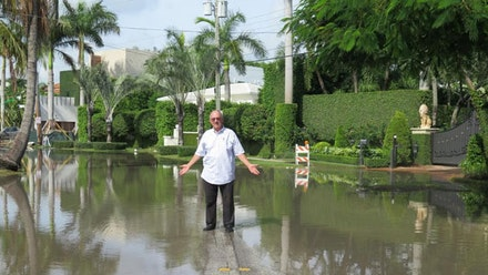 Harold Wanless standing in sunny day floodwater during high tide in Miami Beach, September 28, 2015. Credit: 2015 CBC/Radio-Canada.