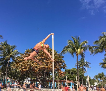Claudita Concha Parraguez (@claukitty9) practicing pole calisthenics at Lummus Park, South Beach, Miami Beach. Photo taken February 11, 2017 by author.