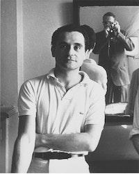 JOHN GIORNO AT HOTEL CHELSEA, 1965. PHOTO: WILLIAM S. BURROUGHS.