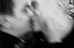 JOHN GIORNO AND UGO RONDINONE KISSING AT CHRISTMAS BRUNCH, 2001. PHOTO: LINA PALLOTTA.