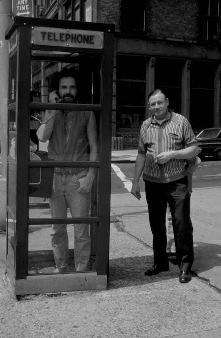 JOHN GIORNO IN PHONE BOOTH, 1971. PHOTO: LES LEVINE.