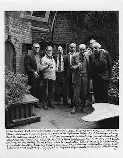 JOHN GIORNO, HENRY GELDZAHLER, ALLEN GINSBERG, FRANCESCO CLEMENTE, WILLIAM BURROUGHS, IRA SILVERBERG, JAMES GRAUERHOLZ, AND ALAN AUSEN IN HENRY GELDZAHLER'S BACK YARD, 1985. PHOTO: RAYMOND FOYE.