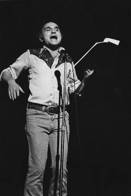 JOHN GIORNO READING AT TOWN HALL IN NEW YORK CITY, 1976.