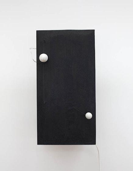 From <em>Alexander Calder: Hypermobility.</em>    Alexander Calder, <em>Two Spheres</em>, 1931, wood, wire, and paint, with motor.  21 1/2