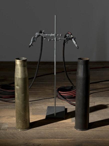 <em>Eastern wind </em>, 2012, Installation, variable sizes Artillery shells (brass), air control/compressor