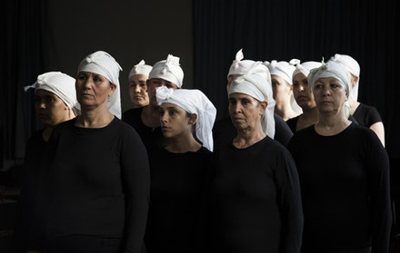 Bouchra Ouizguen: Corbeaux (Crows). Shown left to right: Zahra Bensllam, Malika Soukri, Halima Sahmoud, Fatima El Hanna, Mariam Faquir, Fatima Jaafro, Noura Oujoute, Khadija Amrhar (Photo Credit: Hasnae el Ouarga Compagnie O)