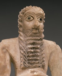 <em>Standing Male Worshiper</em> (detail), Sumerian, ca. 2900-2600 B.C. Gypsum alabaster, shell, black limestone, bitumen, 11 5/8 x 51/8 x 3 7/8 in. Courtesy of the Metropolitan Museum of Art.