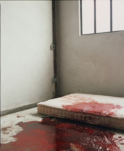 Andres Serrano, <em>Room with Blood (Torture)</em>, 2015. Pigment print, back-mounted on dibond, wooden frame, 60 x 50 inches. Courtesy of the artist.