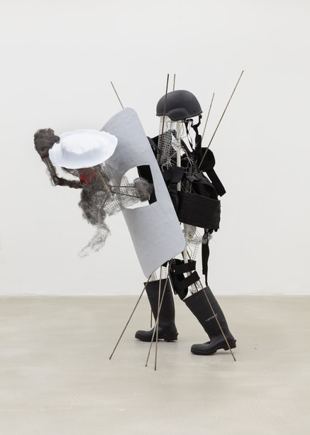 Andrew Ross, <em>Hollow Man With Rubber Boots</em>, 2017. Fiberglass, vinyl plastic, wire mesh, steel wool, 48 x 65 x 52 in. Courtesy the artist and American Medium.